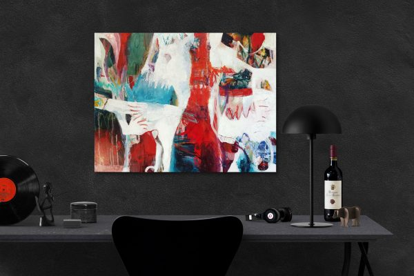 A black desk with black wall and vibrant painting on the wall